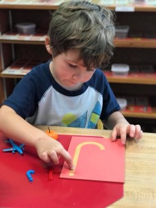 Exploring sounds with sandpaper letters